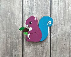This beautiful little creature is now available in my shop 🐿! You'll find there more hand painted colorful accessories easy to match to any outfit. Link in bio! Purple Squirrel, Pallet Sectional, Pallet Chest, Stenciled Table, Old Pallets, Gifts For Your Girlfriend, Unique Gifts For Her, Diy Pallet Furniture, Wooden Earrings