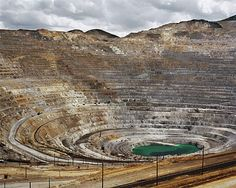Pure copper is a rare occurrence in nature. It is commonly found in minerals such as azurite, malachite, and bornite. It is obtained by smelting, leaching, and electrolysis. The image is a picture of the Kennecott copper mine in Utah.