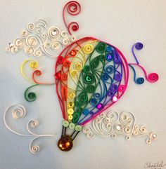 Quilled hot air balloon - My very first quilling project! My sister is pregnant and we don't know the sex yet but I wanted to make something to put in the nursery. :]