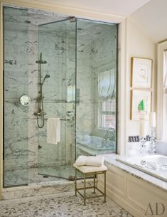 Works by Joan Miró brighten a bath, which features a Calacatta marble shower, a Kallista tub, and Ann Sacks mosaic floor tile; the shower fittings are by Perrin & Rowe, and the stool is by Restoration Hardware. Small Bathroom, Master Bathroom, Bathroom Marble, Downstairs Bathroom, Cottage Design, House Design, Garden Design, Bathroom Inspiration, Design Inspiration
