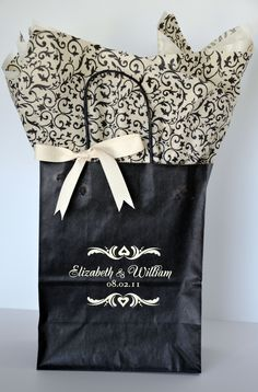 This black #welcomeguestbag is stunning printed in ivory ink. The name format design from our Signature Collection is clean, bold & easy to read. The matching black & ivory scroll #tissuepaper & vanilla #ivorytissuepaper combination is ravishing next to the tailored ivory cream #herringboneribbon. Our designs are available on many bag colors with 35 ink colors. Order as few as 25. Available from your number one source for #weddingwelcomebags. www.FavorsYouKeep.com, online since 2001…
