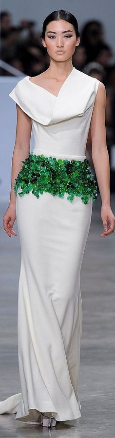 Interesting green stone midrif ornamentation. Stephane Rolland couture
