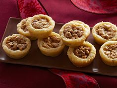 Bess London's Pecan Tassies recipe from Trisha Yearwood - These were so good! Pressed the dough flat with a floured glass. Spray pan 1st. FANTASTIC!