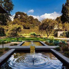 Expansive modern garden with water feature provides a tranquil backyard retreat - Decoist
