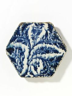 Tile | Made in Damascus, Syria, ca. 1420-1450 | Materials: fritware, painted in underglaze cobalt blue, glazed | Tile, fritware, hexagonal, painted in underglaze blue with swirling foliage | VA Museum, London
