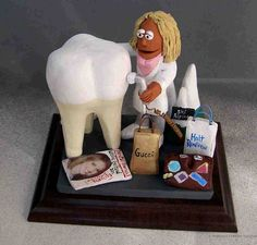 Customized gift for a Female Dentist by www.magicmud.com any orthodontist, periodontist, endodontist, prosthodontist or general dentist is made to order- as well as any other occupation! 1 800 231 9814  $200-250 #dentist#endodontist#dental#dentistry#orthodontist#periodontist#prosthodontist#OralSurgeon#graduation#office-gift #anniversary #birthday #cake toppers#figurine#gift