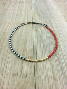 Adjustable Red, Black, White & Gold Mix Beaded Bracelet, Simple Bracelet, Dainty Bracelet, Friendship Bracelet, Funky, Modern, Abstract by HBHDesignStudio on Etsy https://www.etsy.com/listing/241834769/adjustable-red-black-white-gold-mix
