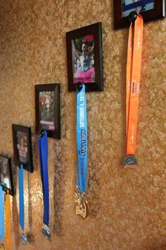 Back when I first started introducing my recent do-it-yourself projects, I mentioned completing one to display my race medals and that is what I'm sharing with you today! Pin It I have seen different race medal holders that look like Race Medal Holder, Medal Holders, Trophy Display, Award Display, Trophy Shelf, Race Medal Displays, Display Medals, Eat And Run, Disney Marathon