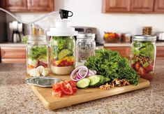 Eliminate a sea of salad supplies in your crisper drawer. Create salad in a jar instead for an easy to-go lunch! Be sure to use your FoodSaver® Jar Sealer to keep recipes in a jar fresh up to 5x longer.  #Foodsaver #summer #salad