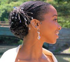 Micro Flat Twists styled in classic bridal chignon.   Micro Flat Twists te geven, gestyled in een klassieke bruidsknot voor een lieve en tijdloze huwelijkse uitstraling.