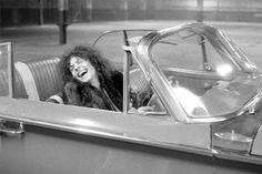 Born to Boogie film set, 1972.  Although some have said that it's ominously, if unwittingly foretold his fatal car accident, this image again shows how much fun Marc was having making the film.