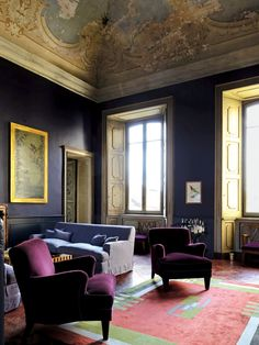 Italian filmmaker Luca Guadagnino, who calls this 17th-century palazzo home, brings the same lush style to his decorating that he does to his movies. The living room is painted in a rich navy that, at times, seems almost black.