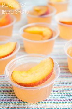 Peach Fizz Jello Shots are about to become your go-to summer cocktail! Super easy to make and crazy good, these shots disappear in a flash! #ad #AlizeinColor
