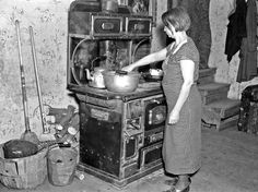 Mrs. Erasty Emvich in her  kitchen. Mrs. Emvich is the wife of a tenant farmer and mother of twelve children, eleven of them living. Near Battle Ground, Indiana, Mar 1937. photo by Russell Lee
