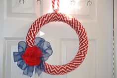 """I actually made this!!! Those of you that know me, know I AM NOT CRAFTY! At all.  I saw something similar to this today for sale for $26.99 and as I almost hit the buy button, decided I could totally do this on my own! Mine isn't as pretty as the one for sale....but I""""m proud of myself for actually doing it.  Ready for the patriotic holidays!"""