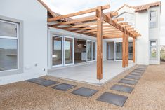 The building represents a timeless design, both inside and out. Situated in Langebaan Country Estate, construction done by Crontech Consulting. Concrete Roof Tiles, Concrete Steps, Concrete Design, Timber Flooring, Vinyl Flooring, La Haye, Outdoor Pergola, Wood Laminate, Country Estate