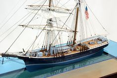 "Newsboy - Erik A.R. Ronnberg, Jr. Model is fully rigged, with furled sails and shown at anchor in a sea which allows a view of the hull below the waterline. 3/16"" = 1' Scale; Class A; Encased: 37 1/2""L x 28 1/4"" H x 13 9/16"" W."