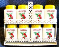 Absolutely Darling USA Spice Shaker Set with a Trellis Rack, too!  Cheery Cherries, from the 50's and Oh So Wonderfully Vintage!  Milk Glass Shakers in TipTop Shape, from TIPP USA.  Screw on tin caps/lids painted yellow.  Truly a Vintage Lover's Kitcshy Keen Gift for the Holidays!