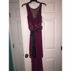Semi Formal Dress/ Dress for Special Occasion Burgundy semi formal dress, In a size large! Never worn, new with the tags. High low dress the top is shear near the straps with sparkles and there is a black belt to tie a bow with on the front. Dresses High Low