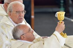 """The pope asked Francisco """"honor the memory and teachings"""" of his predecessors John XXIII and John Paul II, the Saints proclaim in a historic ceremony. (AP)"""