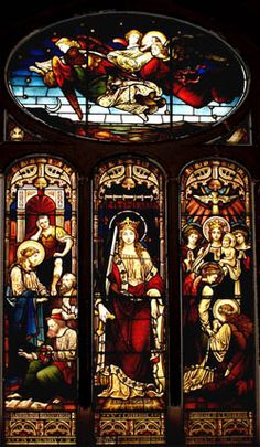 The Choir Window in Christ Espiscopal Church in Tarrytown, NY. The three lower panels show events from Catherine's martyrdom story while the oval above shows her being carried to Heaven. c. 1880.