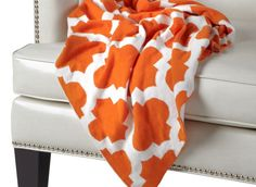 Available for pre-order: Mimosa Throw in quatrefoil orange pattern. $59.95