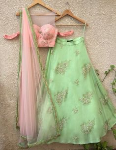 Peach Blouse with Gota Work and pleat cold shoulder detail teamed with Pista Green Buti Lehenga on Net with Raw Silk Underlay and Peach Dupatta with BeadworkComposition : Georgette, Net and Raw SilkAll products can be customised for sleeves, le. Half Saree Lehenga, Green Lehenga, Lehenga Skirt, Lehenga Blouse, Indian Lehenga, Ghagra Choli, Peach Lehnga, Sarees, Kids Lehenga Choli