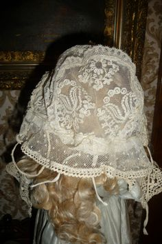 Beautiful doll bonnet with row upon row of lace