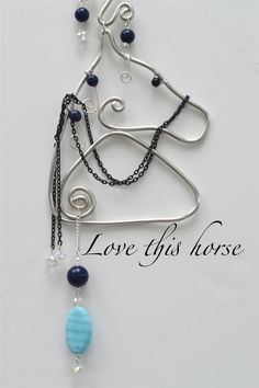 Horse - Mare - stallion Wire Suncatcher created by: Coirnini Company © ™ Barn Yard Animals: Silver or Copper Wire Horse - Mare - stallion with glass crystals with a Glass Prisms, Horse-shoe charm, heart pendant and decorative hanger. Display in a Window, Rearview Mirror or a place you love. www.facebook.com/coirninico If you would like to purchase  a gorgeouse horse, please send me an email to: coirnini@gmail.com or purchase at: https://www.etsy.com/ca/shop/CoirniniCompany