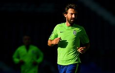 Andrea Pirlo of Juventus looks on during a Juventus training session on the eve of the UEFA Champions League Final match against FC Barcelona at Olympiastadion on June 5, 2015 in Berlin, Germany.