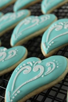 """I was asked to make elegant cookies for an engagement cookies. I chose to use white and """"Tiffany Blue"""" to achieve that elegance. The """"Tiffany Blue"""" color is a trademark of … Blue Cookies, Heart Cookies, Iced Cookies, Sugar Cookies, Frosted Cookies, Sweet Cookies, Tiffany Blue, Azul Tiffany, Cupcakes"""