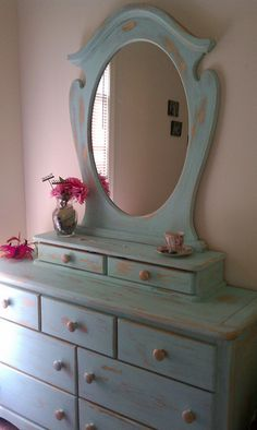 Formerly a little girl's dresser...Now all grown up in a  shabby Robin's egg blue.  J.Sayre 2011