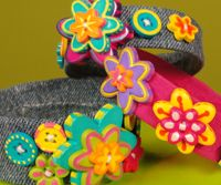 Make a bracelet with old jeans and water bottle. At Hands on Crafts for Kids.