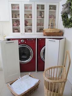 Washer and dryer hidden in a kitchen hutch