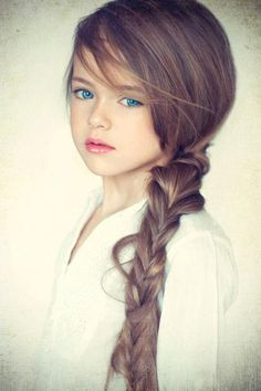 Little Girl with all the beauty a mother should be so proud of.  She looks like a fairy princess!