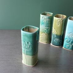 This vase is slab built porcelain and stamped with designs. Love the simplicity and the glaze colors!
