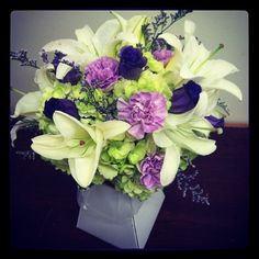 Bride's bouquet- Green hydrangeas, white lilies, lavender carnations, purple lisianthus and caspia.   Flickr - Photo Sharing!