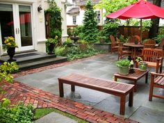 Bluestone terrace with old street paver banding.