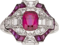 Art Deco Ruby, Diamond, Platinum Ring, Cartier  The ring features an oval-shaped ruby measuring 6.00 x 5.00 x 3.60 mm and weighing approximately 0.65 carat, enhanced by full, baguette and trapezoid-shaped diamonds weighing a total of approximately 0.85 carat, accented by square and baguette-shaped rubies, set in platinum, marked Cartier. Gross weight 5.20 grams.