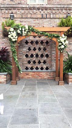 Mason Dupuy  ceremony arch Ceremony Arch, Wedding Ceremony, Courtyard Wedding, Cat Flowers, Arches, Sidewalk, Wreaths, Patio Wedding, Door Wreaths