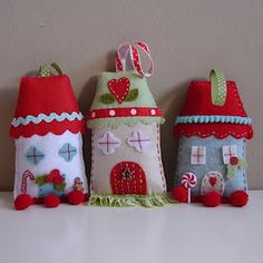 I love these Christmas houses ... teach Emily how to sew and give her flat felt ... make it an activity box, buttons, sequins, beads, floss, thread