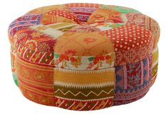 An exuberant addition to any setting, this ottoman is upholstered in colorful kantha cloth. Made of hardwood, the piece easily doubles as a table or a stool. Please note: This piece is made from one-of-a-kind kantha cloth. Each piece is handmade and will vary slightly from the image.