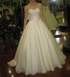 Justin Alexander #8502 @ Ellie's Bridal --This skirt was way too huge, but the waistline was pretty and I like the chiffon (really lightweight)