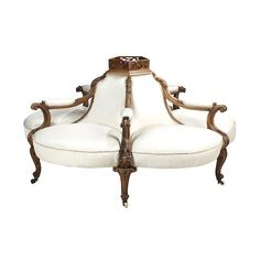 A Victorian walnut conversational sofa