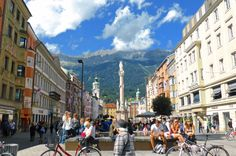 St. Anna's Column, topped by a statue of Madonna, is on Innsbruck's Maria-Theresien-Strasse. The Nordkette mountain range is in the background.