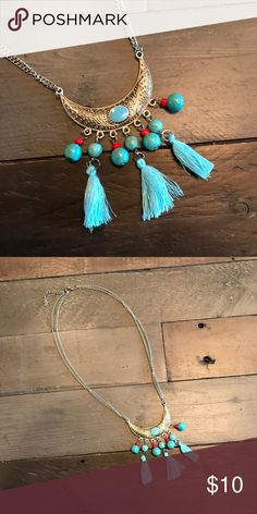 """Boho Turquoise and Tassel Necklace Turquoise colored beads with tassels hanging off a textured silver """"horn"""" Jewelry Necklaces"""