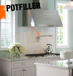 A potfiller is a wall-mounted faucet directly above the stovetop that allows you to easily fill large pots, eliminating the need to carry heavy pots from the sink to the range.