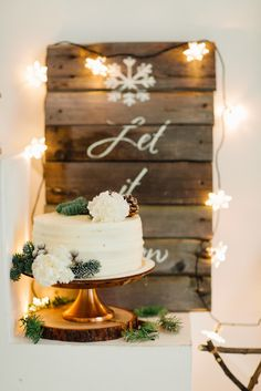 A Winter Wonderland Bridal Shower | Winter can be a great time to host a bridal shower since old friends may be back in their hometowns around the holidays to visit family. We love this snow themed bridal shower complete with a rustic Let It Snow sign and pinecone decor on the cake. Click to see the full party! Ultimate Bridesmaid | Warm Photo