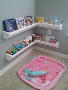 DIY bookshelves made from vinyl rain gutters purchased at home depot. Perfect reading corner just need to find the right corner rug and pillow!