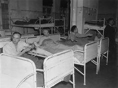 Three survivors rest in their beds at the Hadamar Institute.